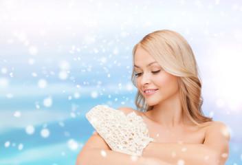 beautiful woman washing herself with wisp