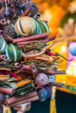 aromatic and multicolored decoration stand in christmas market poster