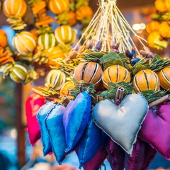 aromatic and multicolored decoration stand in christmas market