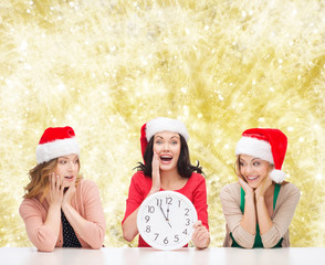smiling women in santa helper hat with clock