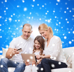 happy family with tablet pc and credit card