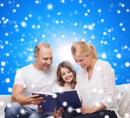 happy family with book at home