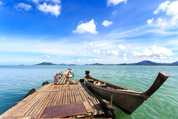 Traditional Thai boat, Long tail stand in the sea at Phuket, Tha