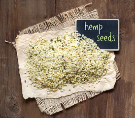 Raw hemp seeds with small chalkboard