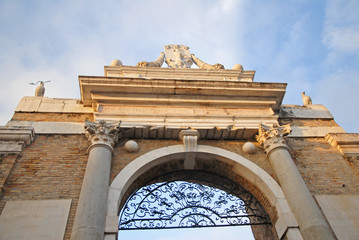 Ravenna, medieval city door  with Pope symbols.
