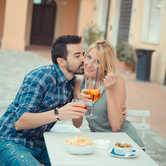 Couple drinking aperitif in a Bar