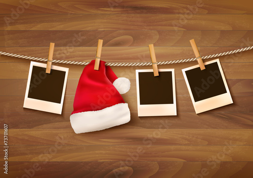 Background with photos and a santa hat. Vector. - 73701607
