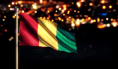 Guinea National Flag City Light Night Bokeh Background 3D