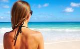 Back of Woman in bikini on the beach.