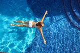 Beautiful woman in the pool.