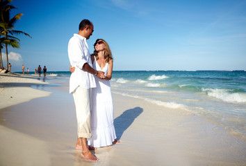 Loving couple relaxing on beach