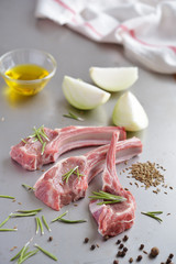 Raw lamb cutlets and spices