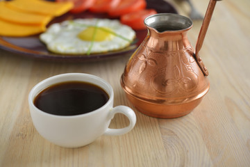 Cup of Turkish coffee and cezve