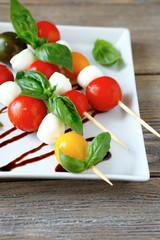 Caprese salad on wooden sticks