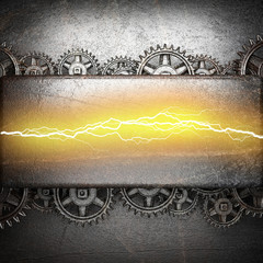 metal background with cogwheel gears and electric lightning