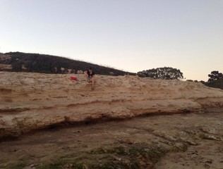 young man relaxing on beach cliffs