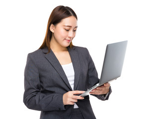 Asian businesswoman look at notebook