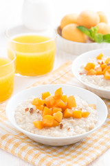 bowl of oatmeal with fresh apricots and orange juice