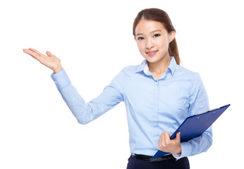 Business woman with clipboard and open hand palm