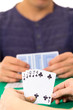 Playing cards closeup of hands holding deck