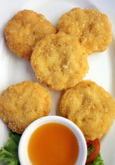 Fried Shrimp Cake on white dish.