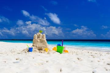 Sand castle on tropical beach