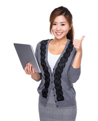 Woman use of digital tablet and thumb up