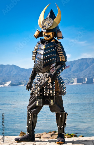 Japanese samurai costume in Miyajima, Japan. - 73707899