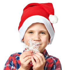 Little boy in red Santa hat with snowflake