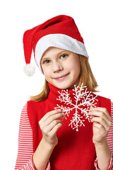 Beautyful girl in red Santa hat with snowflake