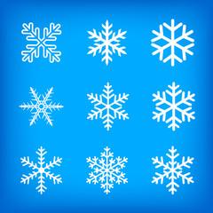 white snowflakes on blue background
