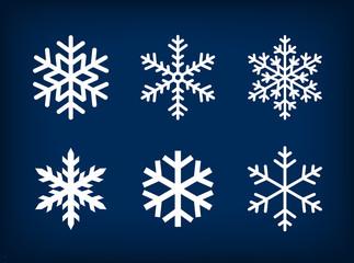 white snowflakes on dark blue background