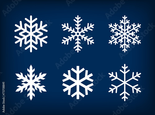 white snowflakes on dark blue background poster