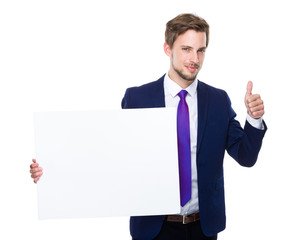 Businessman with white board and thumb up