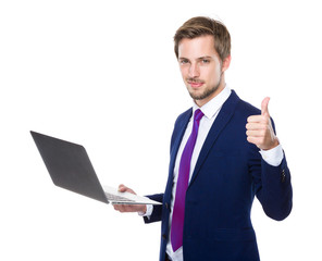 Businessman use of notebook and thumb up