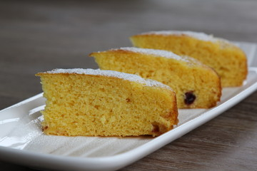 Yellow cake with cranberries topped with icing sugar