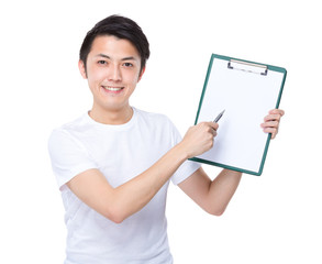 Man with pen point to clipboard