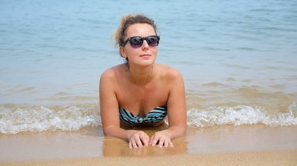 Happy Young Woman in Sunglasses in the Sea. Slow Motion.