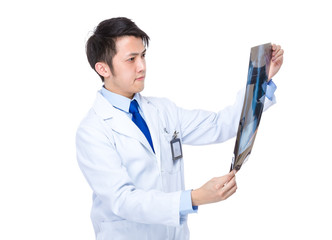 Doctor look at xray film