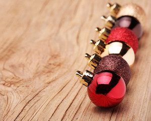 Christmas Balls Over Wooden Background