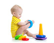 funny baby boy playing with colorful toy