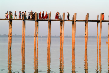 People walking on the wooden bridge of U Bein on river Ayeyarwad