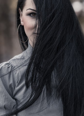 Woman face with long black hair