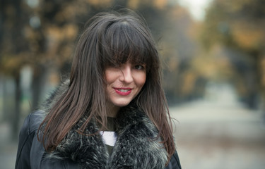 Happy young smile woman wearing fur