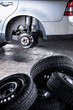 inside a garage - changing wheels/tires