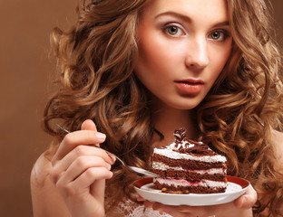 beautiful young woman with a cake