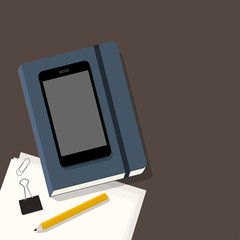 Office workplace with notepad, phone, pencil & papers