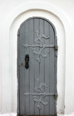 wooden door with wrought iron ornament on it