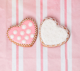 two heart cookies on pink