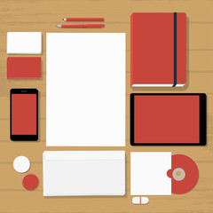 Empty red stationary set on wooden background